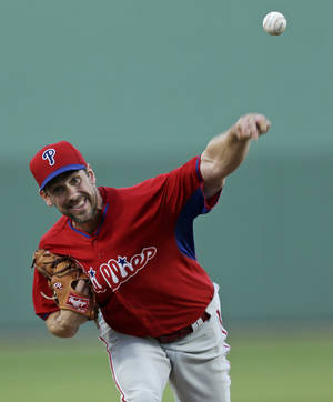 Photo - Philadelphia Phillies starting pitcher Cliff Lee pitches in the first inning of an exhibition baseball game against the Boston Red Sox in Fort Myers, Fla., Saturday, March 15, 2014. (AP Photo/Gerald Herbert)