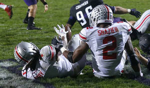 Photo - Ohio State cornerback Bradley Roby (1) recovers a blocked punt by Northwestern's Brandon Williams in the end zone for a touchdown during the first half of an NCAA football game on Saturday, Oct. 5, 2013, in Evanston, Ill. Assisting on the play is linebacker Ryan Shazier. (AP Photo/Charles Rex Arbogast)