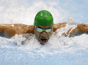 Photo -   Achmat Hassiem of South Africa swims in the men's 100 meter butterfly S10 race at the 2012 Paralympics games, Saturday, Sept. 1, 2012, in London. (AP Photo/Alastair Grant)