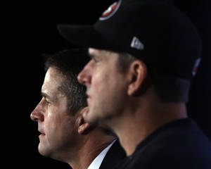 Photo - San Francisco 49ers head coach Jim Harbaugh and Baltimore Ravens head coach John Harbaugh participate in a news conference for the NFL Super Bowl XLVII football game Friday, Feb. 1, 2013, in New Orleans. (AP Photo/Patrick Semansky)