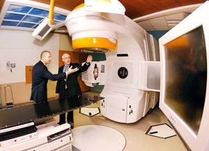 photo - Phil Lance, left, president of the Integris Cancer Institute of Oklahoma, talks to Gov. Brad Henry in the radiation oncology area during Wednesday's grand opening celebration. PHOTO BY JIM BECKEL, THE OKLAHOMAN