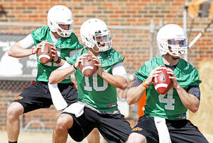 Photo - From left, quarterbacks Wes Lunt, Clint Chelf and J.W. Walsh. Photo by Bryan Terry, The Oklahoman