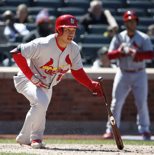 Photo - St. Louis Cardinals' Kolten Wong watches his fifth-inning single off New York Mets starting pitcher Bartolo Colon in a baseball game against the New York Mets in New York, Thursday, April 24, 2014. Wong later scored on a Tony Cruz double to left field. (AP Photo/Kathy Willens)