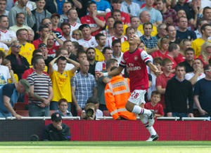 Photo -   Arsenal's Kieran Gibbs celebrates after the opening goal against Southampton's is scored during their English Premier League soccer match at the Emirates stadium, London, Saturday, Sept. 15 , 2012. (AP Photo/Tom Hevezi)