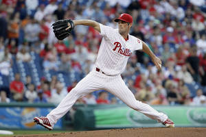 Photo - Philadelphia Phillies' Cole Hamels pitches in the first inning of a baseball game against the New York Mets, Friday, June 21, 2013, in Philadelphia. (AP Photo/Matt Slocum)