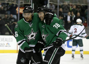Photo - Dallas Stars' Trevor Daley (6) congratulates center Vernon Fiddler (38) on his goal against the Minnesota Wild in the first period of an NHL hockey game, Tuesday, Jan. 21, 2014, in Dallas. (AP Photo/Tony Gutierrez)