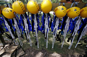 Photo - Safety equipment waits to be used during a Zipline Canopy Tour at Postoak Lodge and Retreat in north Tulsa. JOHN CLANTON/Tulsa World <strong>John Clanton</strong>