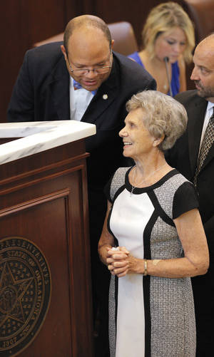 Photo -  Oklahoma state Rep. Mike Shelton, D-Oklahoma City, leans over to talk to Frances Percival as she is honored on the floor of the House of Representatives for 52 years of service as a Millwood School District volunteer, and for serving as a member of the Millwood Public Schools board of education since 1970. Photo by Paul B. Southerland, The Oklahoman  <strong>PAUL B. SOUTHERLAND -  PAUL B. SOUTHERLAND </strong>