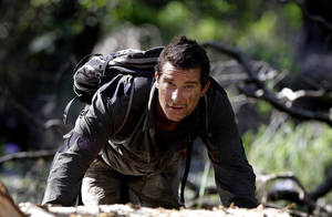 "Photo -   In this May 25, 2010 publicity image released by Discovery Channel, adventurer Bear Grylls is shown at Mount Borradaile in Australia's north-western Arnhemland during filming of the series, ""Man vs. Wild."" NBC said Monday, Oct. 8, 2012, that it is making a competition series with Grylls. The NBC series, ""Get Out Alive,"" is planned for airing next summer. In it, Grylls will guide two teams in adventures. He says competitors will learn survival skills and teamwork but will have to suffer some pain before being rewarded in the end. (AP Photo/Discovery Channel, Luis Enrique Ascui)"