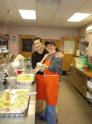 photo - Chef Lucas Barnes and Lina Henneman volunteer at Other Options' annual meal. Photo provided