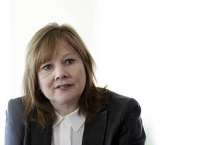 Photo - General Motors CEO Mary Barra addresses the media during a roundtable meeting with journalists in Detroit, Thursday, Jan. 23, 2014. (AP Photo/Carlos Osorio)