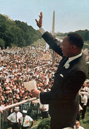 "Photo - FILE - This Aug. 28, 1963, file photo shows Dr. Martin Luther King Jr. acknowledging the crowd at the Lincoln Memorial for his ""I Have a Dream"" speech during the March on Washington. Next Wednesday, the nation's first black president will stand near the spot where Martin Luther King Jr. stood 50 years ago, a living symbol of the racial progress King dreamed about, and enunciate where he believes this nation should be headed. (AP Photo/File)"