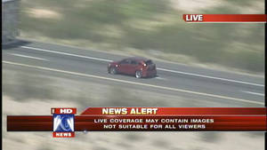 photo -   In this video grab provided by Fox 10 News, a vehicle involved in a police car chase is followed on an interstate highway by a television station helicopter west of Phoenix, Friday, Sept. 28, 2012. Police say a man fatally shot himself in the head on live national television at the end of the high-speed chase that began in Phoenix when the driver stopped, ran into the desert and placed a handgun to his head and fired. (AP Photo/Fox 10 News)