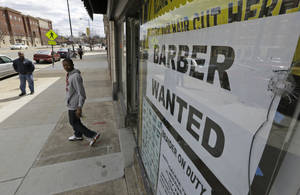 Photo - A help wanted sign is posted at a barber shop in Richmond, Va. U.S. employers added just 88,000 jobs in March, the fewest in nine months.  AP Photo