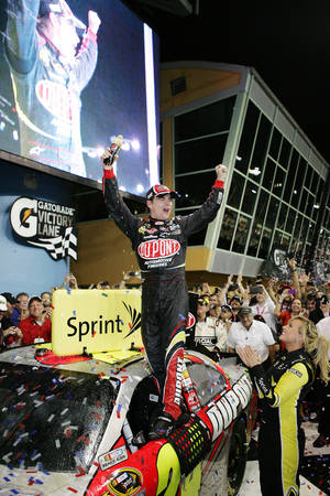 photo -   Jeff Gordon celebrates after winning the NASCAR Sprint Cup auto race at Homestead-Miami Speedway, in Homestead, Fla., Sunday, Nov. 18, 2012. (AP Photo/The Miami Herald, Peter Andrew Uloza) MAGS OUT