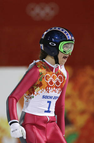 Photo - United States' Sarah Hendrickson smiles after her trial jump during the women's normal hill ski jumping final at the 2014 Winter Olympics, Tuesday, Feb. 11, 2014, in Krasnaya Polyana, Russia. (AP Photo/Gregorio Borgia)