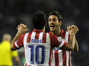 Photo - Atletico's Arda Turan celebrates with Koke, background, after scoring his side's second goal during the Champions League group G soccer match between FC Porto and Atletico de Madrid Tuesday, Oct. 1, 2013, at the Dragao stadium in Porto, northern Portugal. Atletico won 2-1. (AP Photo/Paulo Duarte)