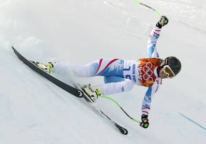 Photo - Austria's Elisabeth Goergl makes a turn during the downhill portion of the women's supercombined at the Sochi 2014 Winter Olympics, Monday, Feb. 10, 2014, in Krasnaya Polyana, Russia. (AP Photo/Charles Krupa)