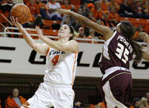 Photo - Oklahoma State's Liz Donohoe (4) goes past Texas State's Erin Peoples (35) to the basket during a women's college basketball game between Oklahoma State University and Texas State at Gallagher-Iba Arena in Stillwater, Okla., Wednesday, Nov. 28, 2012.  Photo by Bryan Terry, The Oklahoman