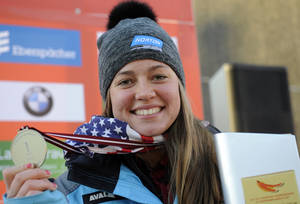 Photo - Placed first United States' Kate Hansen displays her medal during the award ceremony of the women's race at the Luge World Cup event  in Sigulda, Latvia, Saturday, Jan. 25, 2014. (AP Photo/Roman Koksarov, F64)