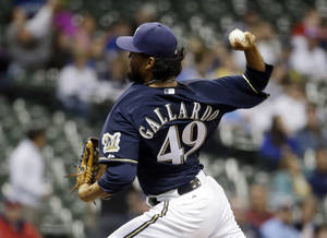 Photo - Milwaukee Brewers starting pitcher Yovani Gallardo throws during the first inning of a baseball game against the San Diego Padres on Tuesday, April 22, 2014, in Milwaukee. (AP Photo/Morry Gash)