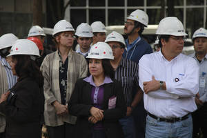 Photo -   Office workers wearing hard hats stand outside of a building that was evacuated after an earthquake was felt in Mexico City, Mexico, Monday April 2, 2012. Mexico was shaken Monday afternoon by a strong apparent aftershock from a powerful earthquake late last month. Officials said there were no immediate reports of serious damage or injuries from the quake, which had an initial magnitude of 6.3. (AP Photo/Dario Lopez-Mills)