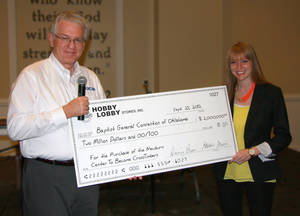 photo - Anthony L. Jordan, Baptist  General Convention of Oklahoma executive director-treasurer, receives a $2 million designated gift from Lauren (Green) McAfee of Hobby Lobby Inc. for the purchase of a children's camp near Davis.    <strong> - Provided</strong>