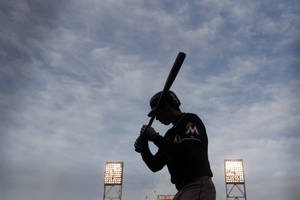 Photo - Miami Marlins' Christian Yelich waits on deck for his turn at bat during the fourth inning of a baseball game against the San Francisco Giants on Saturday, May 17, 2014, in San Francisco. (AP Photo/Marcio Jose Sanchez)