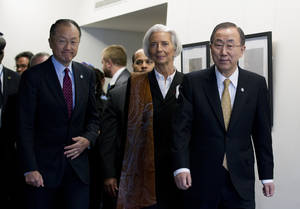 Photo - International Monetary Fund (IMF) Managing Director Christine Lagarde, center, accompanied by World Bank President Jim Yong Kim, left, and UN Secretary General Ban Ki-moon, meet with reporters during the World Bank Group- International Monetary Fund Spring Meetings in Washington, Friday, April 11, 2014. ( AP Photo/Jose Luis Magana)