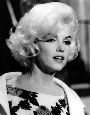 "Photo - FILE-  This April 1962 file photo shows actress Marilyn Monroe on the set of ""Something's Got To Give,"" in Los Angeles. In the Hollywood landscape of new, new, new, what really stands out on the red carpet is that today's starlets still emulate the looks of classic screen beauties, including Elizabeth Taylor, Marilyn Monroe and Rita Hayworth, who ruled the red carpet in the 1950s.    (AP Photo/File)"