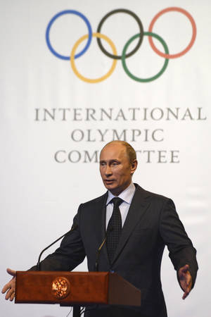 Photo - Russian President Vladimir Putin speaks at an International Olympic Commitee (IOC) executive board meeting at the SportAccord International Convention in St. Petersburg, Russia, Thursday, May 30, 2013. (AP Photo/Kirill Kudryavtsev, Pool)