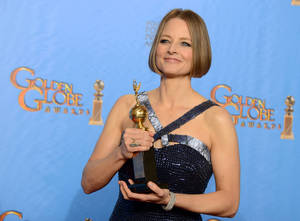 Photo - Jodie Foster poses with the Cecile B. DeMille Award for outstanding contribution to the entertainment field backstage at the 70th Annual Golden Globe Awards at the Beverly Hilton Hotel on Sunday in Beverly Hills, Calif. PHOTO BY JORDAN STRAUSS/INVISION/AP) <strong>Jordan Strauss - Jordan Strauss/Invision/AP</strong>