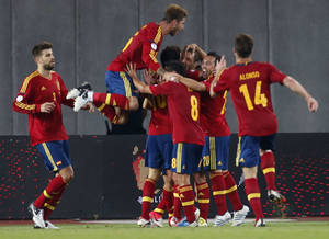 Photo -   Spain's team players celebrates a goal against Georgia during their World Cup 2014 Group I qualifying soccer match between Georgia and Spain in Tbilisi, Georgia, Tuesday, Sept. 11, 2012. (AP Photo/Misha Japaridze)