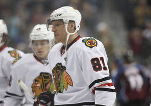 photo - Chicago Blackhawks right wing Marian Hossa, of Slovakia, files off the ice with teammates after the Colorado Avalanche's 6-2 victory in an NHL hockey game in Denver on Friday, March 8, 2013. The Blackhawks lost in regulation for the first time this season. (AP Photo/David Zalubowski)