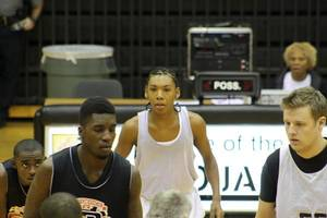 Photo - The OSSAA ruled that eighth-grade phenom Allonzo Trier, center, cannot play for the OKC Storm against association schools. PHOTO PROVIDED