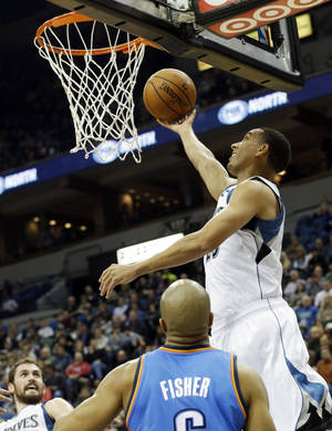 Photo - Minnesota's Kevin Martin, right, puts up a shot against the Thunder on Friday night in Minneapolis.  AP photo