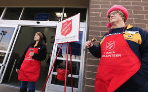 Photo - Volunteers Stacey Steinmetz and Pam Platz, University of Central Oklahoma employees, ring bells while collecting donations for the Salvation Army at a local Wal Mart Edmond Thursday, Dec. 19, 2013.  Photo by Paul B. Southerland, The Oklahoman <strong>PAUL B. SOUTHERLAND - PAUL B. SOUTHERLAND</strong>