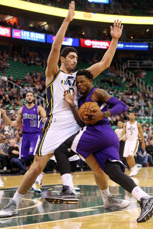 Photo - Utah Jazz's center Enes Kanter (0) defends as Sacramento Kings' guard Ben McLemore (R) drives the basket in the first half of an NBA basketball game on Saturday, Dec. 7, 2013, in Salt Lake City. (AP Photo/Kim Raff)