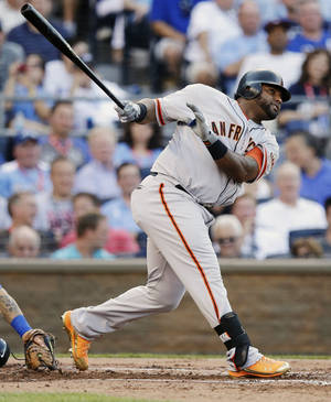 Photo -   National League's Pablo Sandoval, of the San Francisco Giants, hits a three-run triple during the first inning of the MLB All-Star baseball game, Tuesday, July 10, 2012, in Kansas City, Mo. (AP Photo/Charlie Riedel)