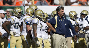 Photo - Georgia Tech's coach Paul Johnson watches during the first half of an NCAA college football game against Miami on Saturday, Oct. 5, 2013, in Miami Gardens, Fla. (AP Photo/J Pat Carter)