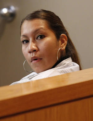 Photo -   Elizabeth Escalona, 23, sits in a courtroom to be sentenced, in Dallas, Monday, Oct. 8, 2012. Escalona pleaded guilty on July 12, 2012, to injury to a child and is facing up to life in prison. A doctor has testified that the Texas mother glued her 2-year-old daughter's hands to a wall and beat the toddler so badly that she suffered significant brain trauma and bleeding inside her skull. (AP Photo/LM Otero)