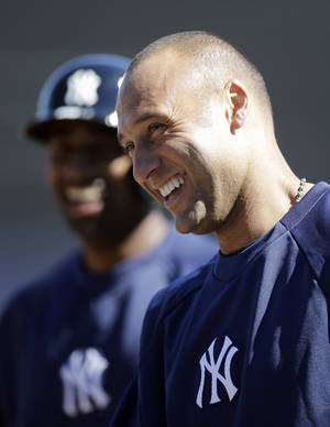 photo - New York Yankees' Derek Jeter, right, and Eduardo Nunez  laugh during batting practice at a workout at baseball spring training, Monday, Feb. 18, 2013, in Tampa. (AP Photo/Matt Slocum)
