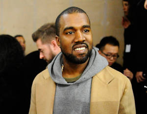 """Photo - FILE - In this Jan. 19, 2014 file photo, singer Kanye West attends the Y-3 men's Fall-Winter 2014-2015 fashion collection, in Paris. West will headline Jay Z's """"Budweiser Made in America"""" festival in Philadelphia. Kings of Leon, Pharrell and Tiesto will also play the two-day festival over Labor Day weekend on the Benjamin Franklin Parkway. (AP Photo/Zacharie Scheurer, file)"""