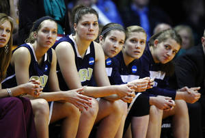 Photo - Oral Roberts players watch from the bench during the final minutes of a first-round game in the women's NCAA college basketball tournament against Tennessee, Saturday, March 23, 2013, in Knoxville, Tenn. Tennessee won 83-62. (AP Photo/Wade Payne)
