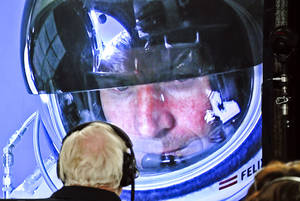 Photo -   In this photo provided by Red Bull, pilot Felix Baumgartner of Austria is seen in a screen at mission control center in the capsule during the final manned flight for Red Bull Stratos in Roswell, N.M. on Sunday, Oct. 14, 2012. Baumgartner plans to jump from an altitude of 120,000 feet, an altitude chosen to enable him to achieve Mach 1 in free fall, which would deliver scientific data to the aerospace community about human survival from high altitudes.(AP Photo/Red Bull, Stefan Aufschnaiter)