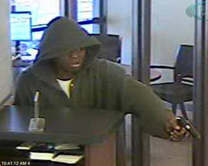 photo - Surveillance photos show two robbers Tuesday morning at Bank of Oklahoma, 2601 N Meridian Ave., in Oklahoma City. Photos provided