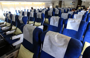 Photo - The disaster in Japan is likely to affect travel to and from Japan for some time as on this South Korean flight to Japan with many empty passengers seats.AP Photo