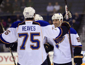 photo - St. Louis Blues' Barret Jackman, right, celebrates his goal against the Columbus Blue Jackets with teammate Ryan Reaves during the first period of an NHL hockey game Thursday, Jan. 31, 2013, in Columbus, Ohio. (AP Photo/Jay LaPrete)