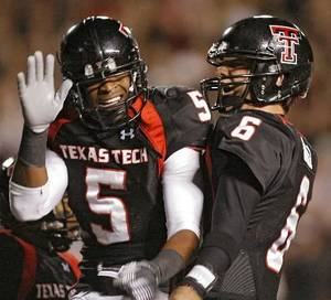 photo - Texas Tech's Michael Crabtree (5) and Graham Harrell (6) celebrate after a Crabtree touchdown during the first half of the college football game between the Oklahoma State University Cowboys (OSU) and the Texas Tech Red Raiders at Jones AT