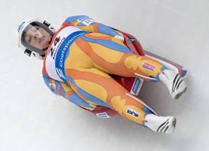 Photo - Erin Hamlin of the US speeds in the ice channel during the first run at the women luge World Cup race in Altenberg, eastern Germany, Sunday, Jan. 19, 2014. (AP Photo/Jens Meyer)